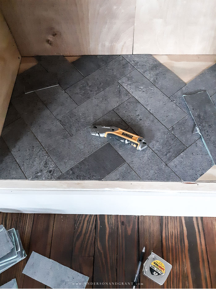 Vinyl tile in herringbone patter