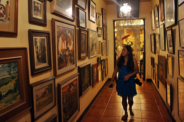 Kara Santos marveling at the many artworks in Villa Escudero