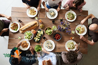 Vitaral Nutrition - Causes and Prevention of High Cholesterol table full of healthy food