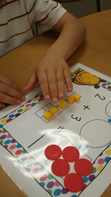 Addition mats help students understand the act of addition.