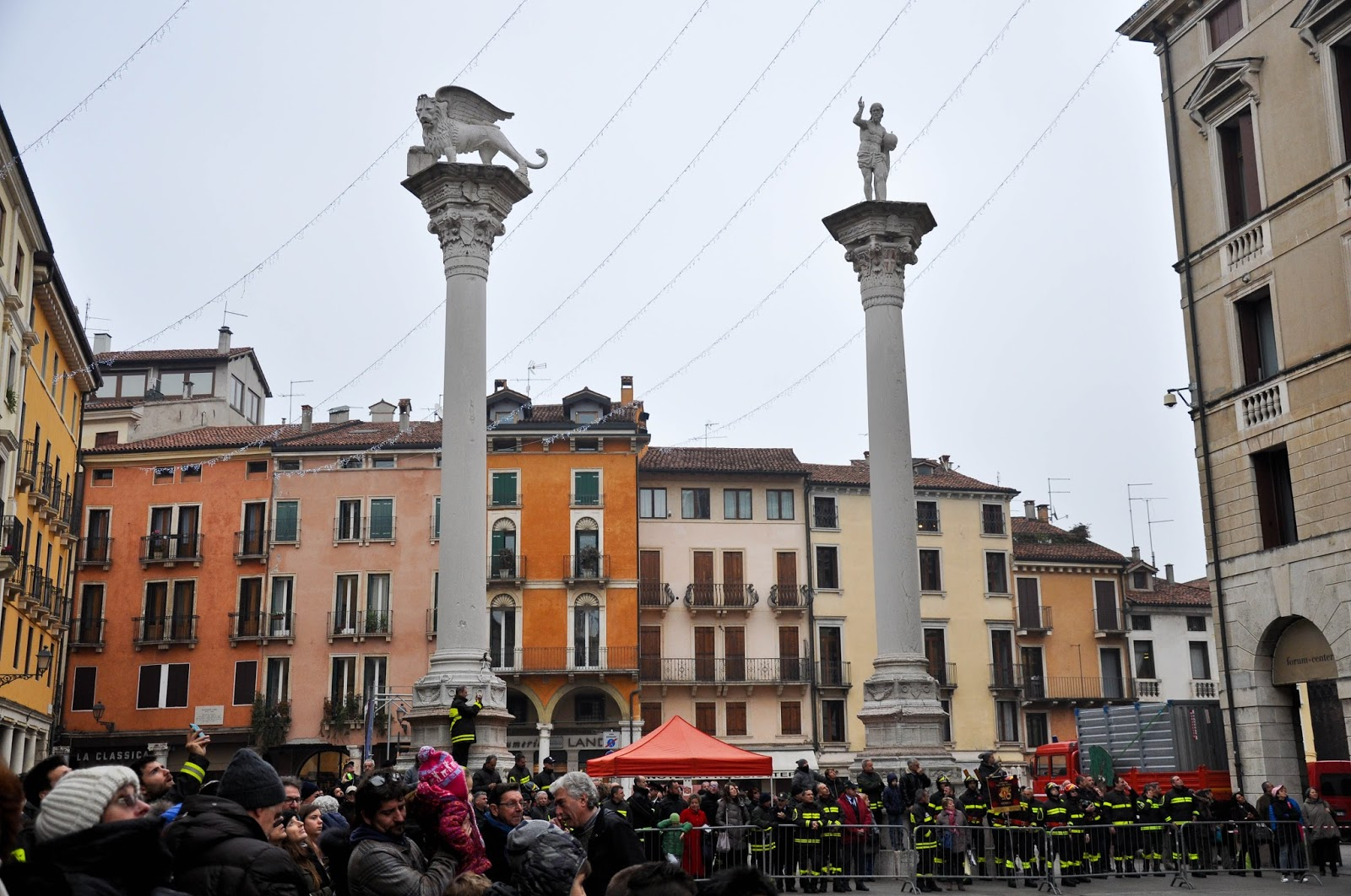 The crowd watching the demonstration of the firefigters on Piazza dei Signori, Saint Barbara celebration, Vicenza, Veneto, Italy