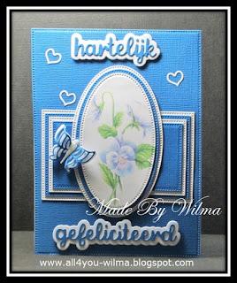 Rechthoekige felicitatiekaart met een ovaal plaatje, kleine hartjes en een vlinder. Rectangular congratulatory card with an oval image, little hearts and a butterfly.