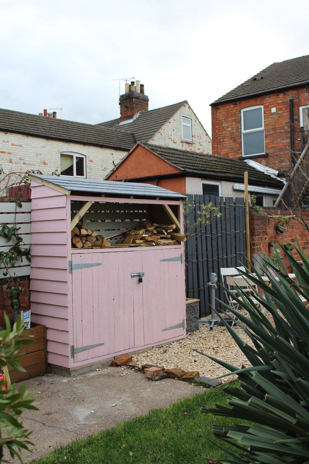 pink log shed in the garden