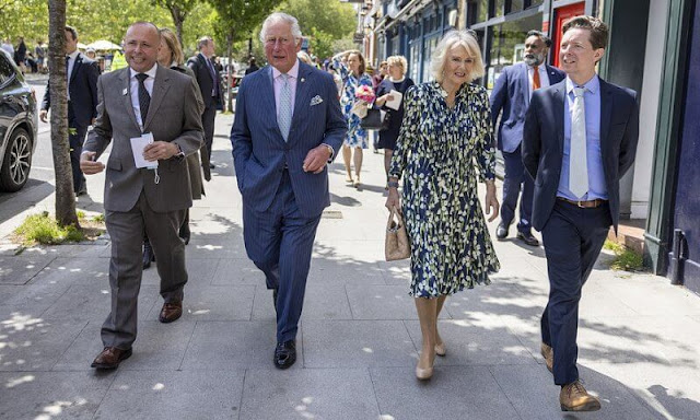 The Duchess of Cornwall wore a floral print silk dress by designer, Fiona Clare. Camilla carried for her Bottega Veneta bag