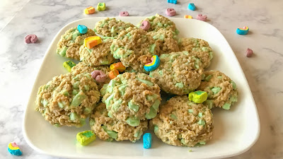 Chocolate oatmeal cookies on a plate with Lucky Charms marshmallows.