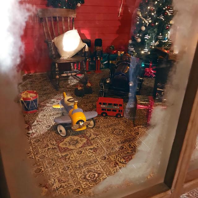 Snowy window looking into Santa's house