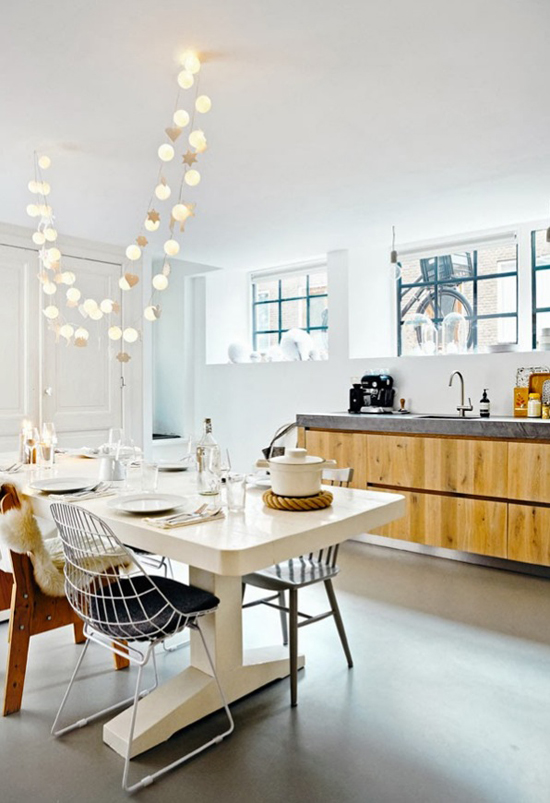 String lights over the dining table. Image by Ernie Enkelaar for 101 woonideeën via the Style Files.