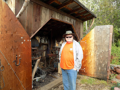 Paul Standing In Front of the Blacksmith Shop