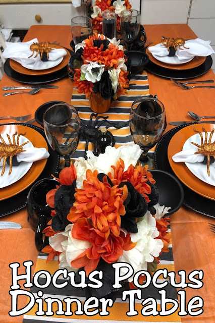 Have a fun dinner and movie night with your family for your Halloween party with this Hocus Pocus dinner tablescape. It's so easy and cheap to put together, that you'll be sad you didn't party sooner!