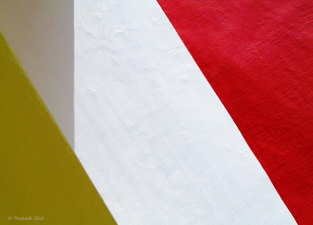 A Minimalist Photo of yellow red and white wall