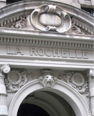 This photo features the upper portion of a 19th century prewar apartment building named La Rochelle. It is located on the UWS of NYC.