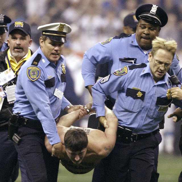 Serial streaker Mark Roberts at the 2004 super bowl. Sponsored by the GoldenPalace.