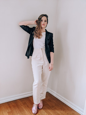 Nyc fashion blogger Kathleen Harper wearing a neutral white outfit with a black blazer.