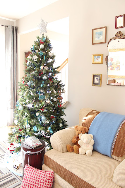 artificial tree decorated with blue ornaments and garland