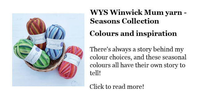 Four balls of Winwick Mum Seasons collection yarn in a basket