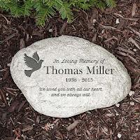 http://www.inspirationalsympathygifts.com/personalizeddovegardenmemorialstone