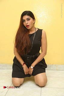 Tollywood Upcoming Actress Pooja Roshan Stills in Black Short Dress at Plus 1 Movie Trailer Launch  0251.JPG