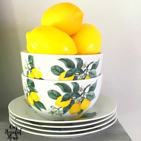 three faux lemons lemons bowls plates