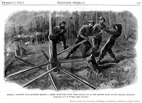 A. W. Warren sketch, General Warren's Raid — Soldiers Making a Greek Cross (Fifth Corps Badge) Out of Heated Rails of The Wilmington And Weldon Railroad, south of Petersburg, VA; p. 837 Harper's Weekly, 31 Dec 1864. Retrieved 2021 from University of Michigan contribution to HathiTrust Digital Library.