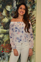 Actress Pragya Jaiswal Latest Pos in White Denim Jeans at Nakshatram Movie Teaser Launch  0065.JPG