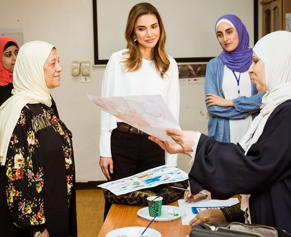 Queen Rania wore FRAME Le Palazzo Pants and STELLA MCCARTNEY Marion Split Sleeve Cady top during visit to Families Development Association