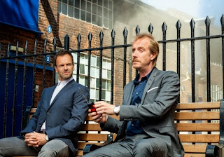 Jonny Lee Miller and Rhys Ifans as Sherlock Holmes and Mycroft Holmes in CBS Elementary Season 2 Episode 1 Step Nine