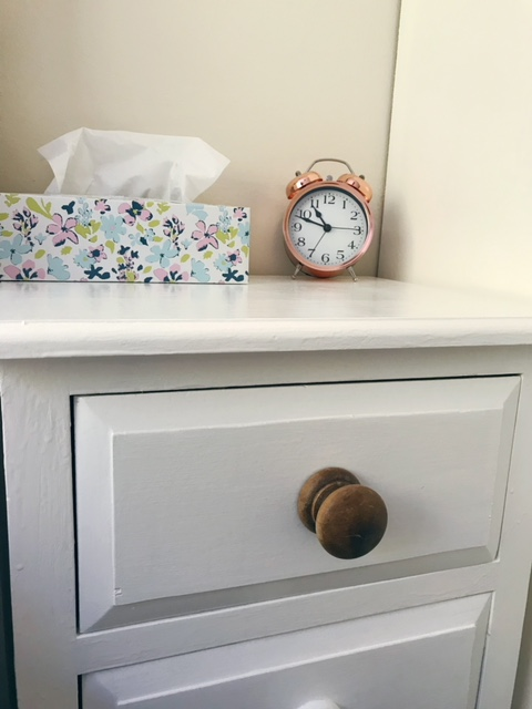 Beside drawers showing wooden handles