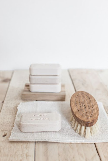 Slow living vignette with handmade soaps and wood bathing brush - found on Hello Lovely Studio