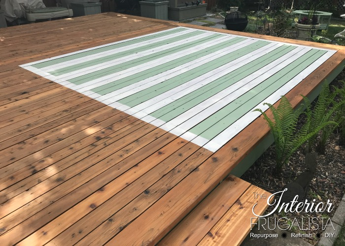 How to hand paint an outdoor faux area rug on a wood deck with stain. An easy DIY outdoor rug idea for creating a cozy conversation area on your deck!