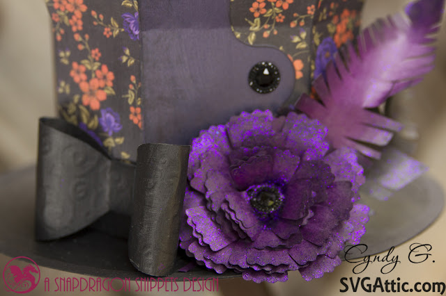 Close up of hat showing flower and bow