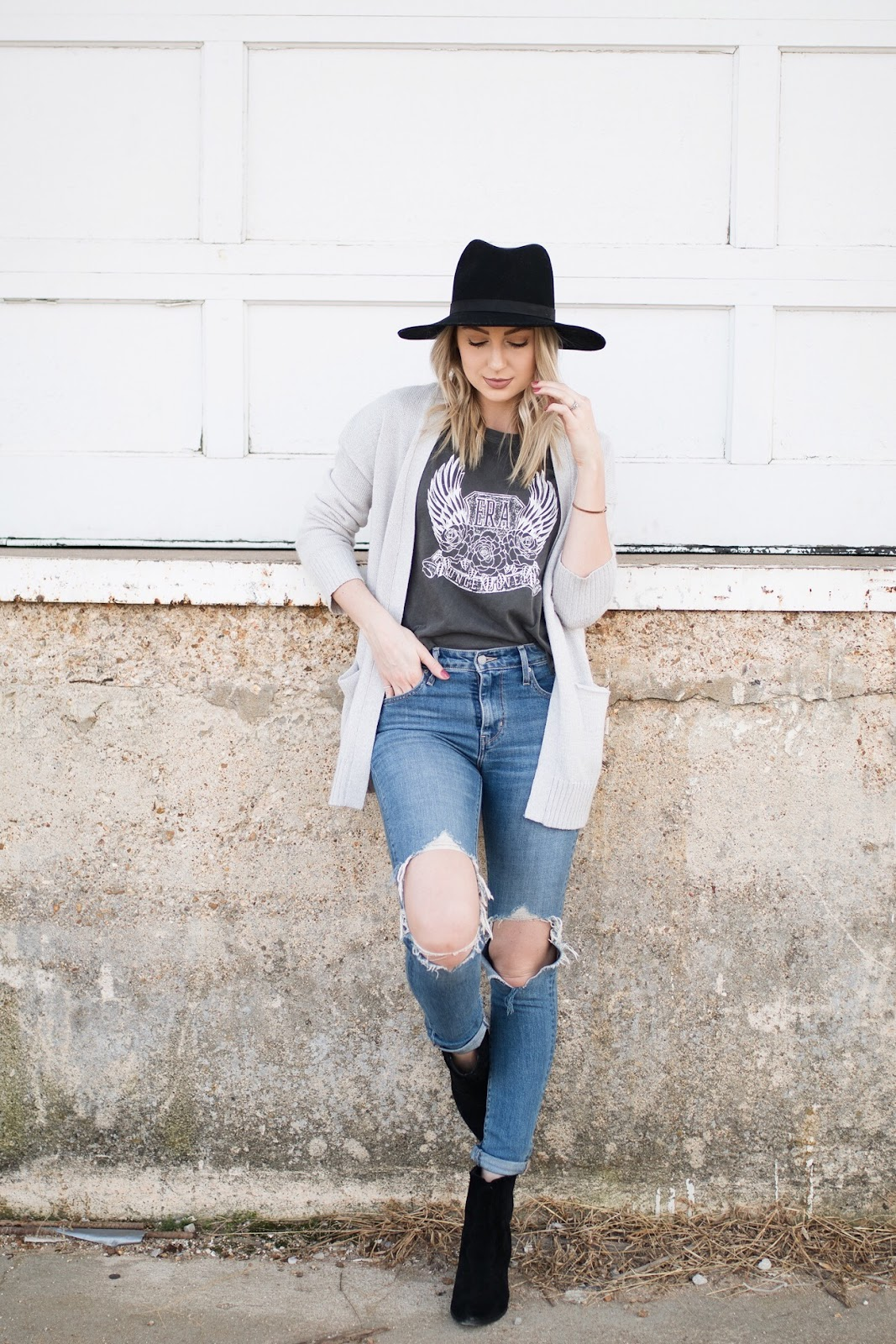 casual transitional outfit: ripped jeans, band tee, cardigan