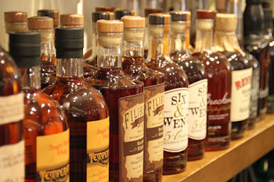 A row of whiskey showing that drinking is one of the biggest causes of stress-related health problems.