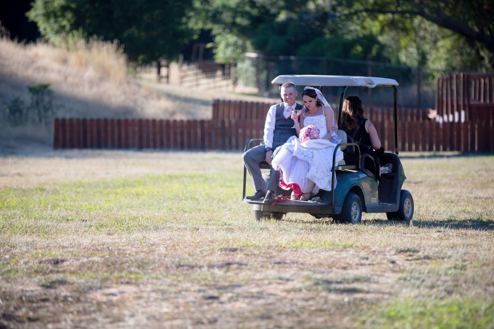 bride in a golf cart