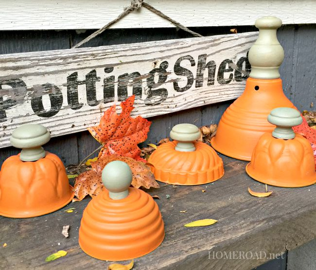 Orange painted vintage tins with knob stems