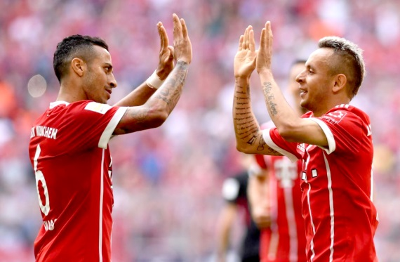 Thiago Alcantara and Rafinha of Bayern Munich