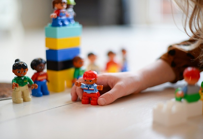 girl playing with duplo people
