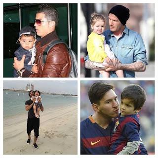 pemain-sepakbola-gendong-anak