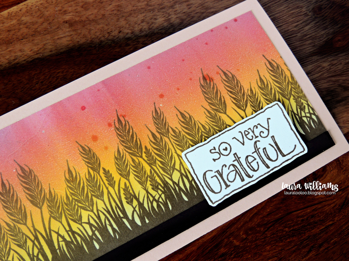 """This is a slimline size handmade card (8.5x3.5"""") It features a wheat field stamped onto a blending pink, orange, and yellow sky that looks like sunrise or sunset. The sentiment says So Very Grateful. This would be a perfect handmade card for autumn thank you cards, or Thanskgiving cards. All of the stamps are from Impression Obsession."""
