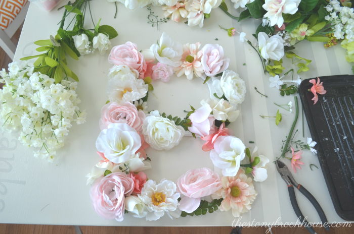 Placing Flowers on Floral Letter