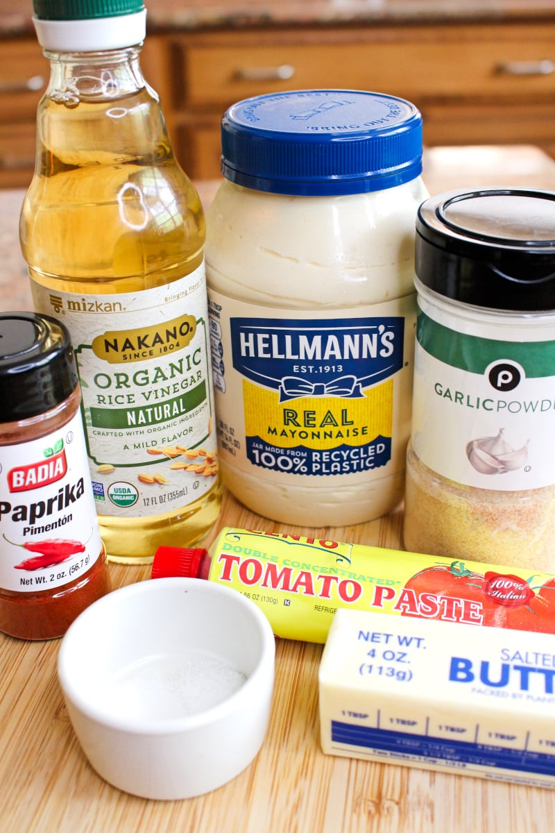 Side view of ingredients in original bottles and packaging sitting on a cutting board.