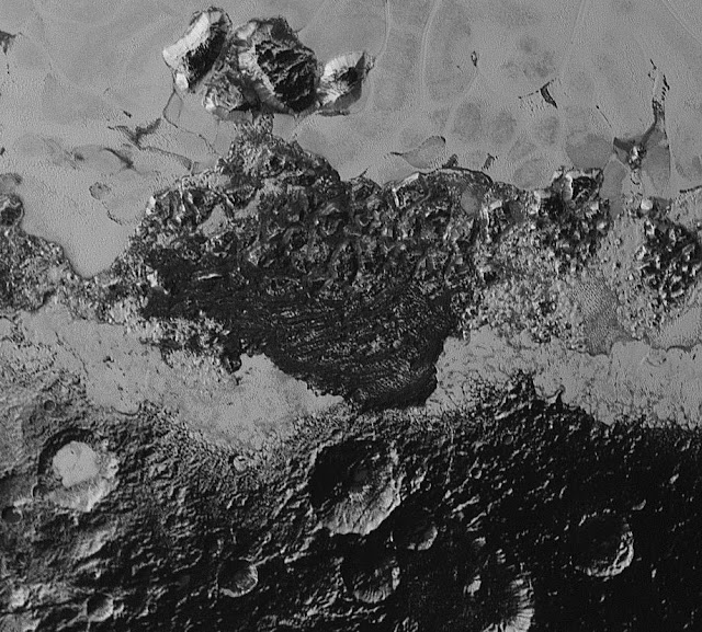 This 220-mile (350-kilometer) wide view of Pluto from NASA's New Horizons spacecraft illustrates the incredible diversity of surface reflectivities and geological landforms on the dwarf planet. The image includes dark, ancient heavily cratered terrain; bright, smooth geologically young terrain; assembled masses of mountains; and an enigmatic field of dark, aligned ridges that resemble dunes; its origin is under debate. The smallest visible features are 0.5 miles (0.8 kilometers) in size. This image was taken as New Horizons flew past Pluto on July 14, 2015, from a distance of 50,000 miles (80,000 kilometers).   Credit: NASA/Johns Hopkins University Applied Physics Laboratory/Southwest Research Institute