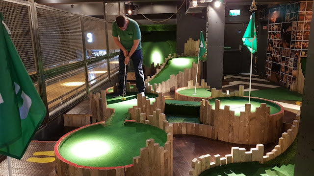 Playing minigolf at Lane7 in Newcastle