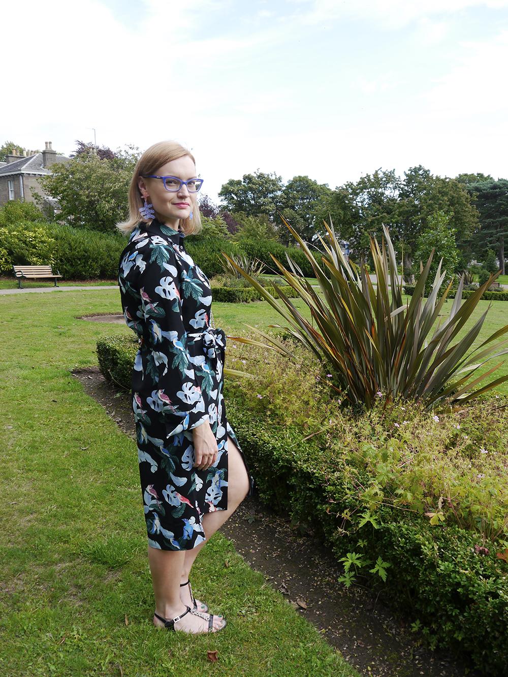 Fashion blogger Wardrobe Conversations styles a tropical Monki shirt dress with statement Julia de klerk earrings