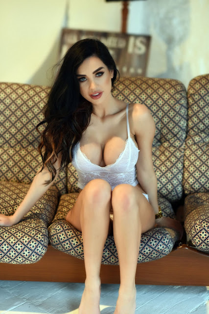 Ann Denise White Lingerie sitting sexy showing cleavge