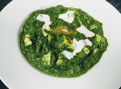 Garnished palak paneer with cream and butter for palak paneer recipe