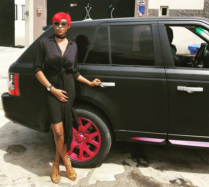 Cynthia Morgan flaunts her red hair and matching Range Rover