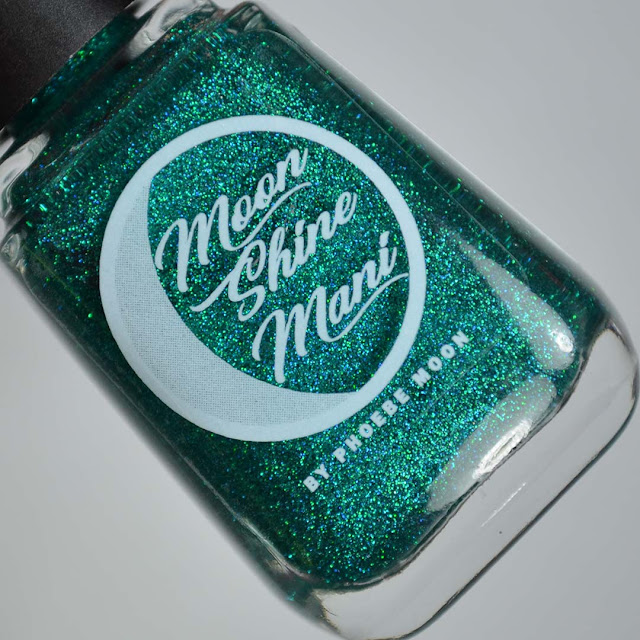 jade holographic glitter nail polish in a bottle