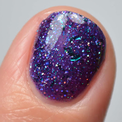 purple glitter nail polish close up