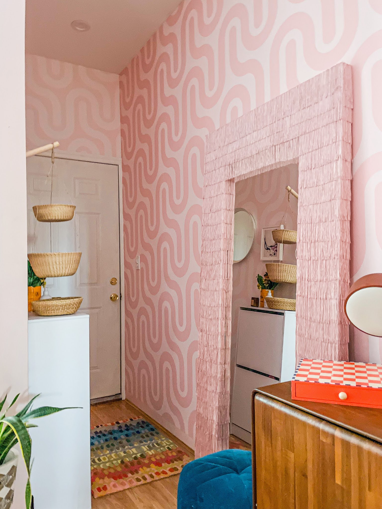 wallpaper ideas // colorful homes // maximalist home decor // pink home decor // retro home decor // retro wallpaper ideas // entryway decor // entryway ideas // small space decor ideas // maximalist homes // small space entryway storage solution