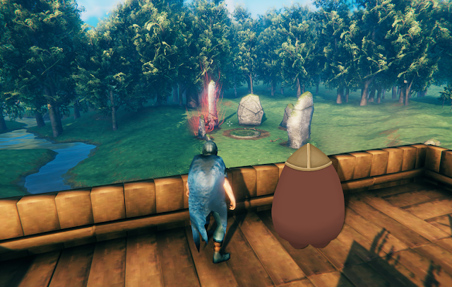 Two characters on a deck overlooking a meadow with large glowing stones.